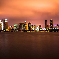 Photo of San Diego at night with downtown San Diego skyscraper office buildings along San Diego Bay. Image is high resolution and was taken in 2012.