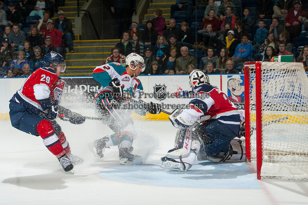 KELOWNA, CANADA - MARCH 8: Tyrell Goulbourne #12 of the Kelowna Rockets takes a shot on Evan Sarthou #31 of the Tri City Americans during third period on March 8, 2014 at Prospera Place in Kelowna, British Columbia, Canada.   (Photo by Marissa Baecker/Getty Images)  *** Local Caption *** Tyrell Goulbourne; Evan Sarthou; Braden Purtill;