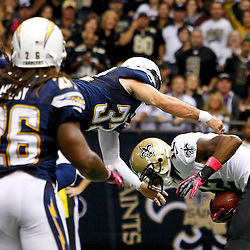 October 7, 2012; New Orleans, LA, USA; New Orleans Saints wide receiver Marques Colston (12) catches a touchdown past San Diego Chargers free safety Eric Weddle (32) during the third quarter of a game at the Mercedes-Benz Superdome. Mandatory Credit: Derick E. Hingle-US PRESSWIRE