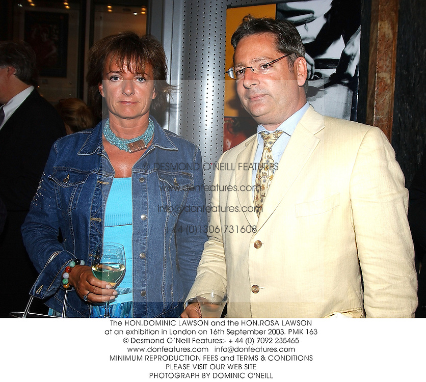 The HON.DOMINIC LAWSON and the HON.ROSA LAWSON at an exhibition in London on 16th September 2003.PMK 163