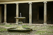 Rome, Italy, November, 2006-A fountain in the courtyard of the 12th century Basilica of San Clemente.