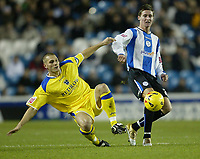 Photo: Aidan Ellis.<br /> Sheffield Wednesday v Cardiff City. Coca Cola Championship. 09/11/2005.<br /> Cardiff's Darren Purse c hallenges Sheffield's Barry Corr