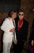 Sir Elton John, Theo Fennell party to celebrate their 21st Anniversary. The Collection. 28 October 2003. © Copyright Photograph by Dafydd Jones 66 Stockwell Park Rd. London SW9 0DA Tel 020 7733 0108 www.dafjones.com