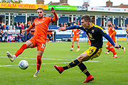 Oxford United midfielder Josh Ruffels (14) crosses the ball during the EFL Sky Bet League 1 match between Luton Town and Oxford United at Kenilworth Road, Luton, England on 4 May 2019.
