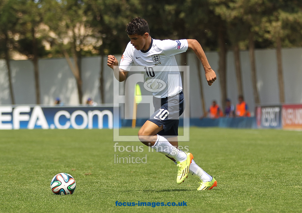 Dominic Solanke of England runs with the ball during the 2014 UEFA European Under-17 match at Gozo Stadium, Xewkija<br /> Picture by Tom Smith/Focus Images Ltd 07545141164<br /> 12/05/2014