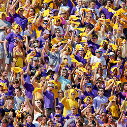 Oct 12, 2013; Baton Rouge, LA, USA; LSU Tigers fans cheer from the stands during the first quarter of a game against the Florida Gators at Tiger Stadium. Mandatory Credit: Derick E. Hingle-USA TODAY Sports