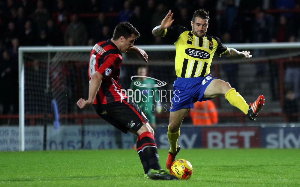 Peter Murphy clears during the Sky Bet League 2 match between Morecambe and Dagenham and Redbridge at the Globe Arena, Morecambe, England on 1 December 2015. Photo by Pete Burns.