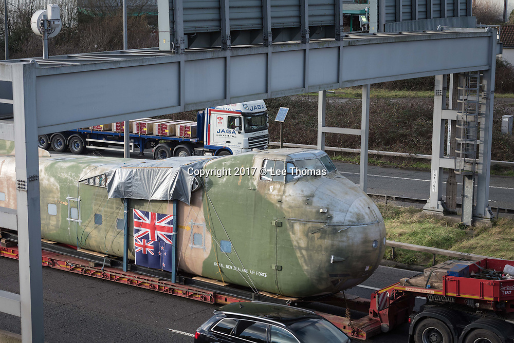 Bristol, UK. 4th January 2018. A 1954 Bristol-built aeroplane returns to its place of manufacture after an 11,000-mile trip having been shipped from New Zealand where it had served in the air force until 1977 before being left to fall into disrepair. The Bristol Type 170 Freighter is one of the last remaining complete Freighters in existence and comes with a 10-tonne, 21m (69ft) fuselage and a wingspan of 33m (108ft). Travelling from Bristol Port in Portbury to Filton the plane has been divided into three parts by the New Zealand Royal Air Force for the journey – the fuselage, the wings and the landing gear. The Freighter will be reassembled, restored and put on display at the Aerospace Bristol museum in Filton once funds have been raised for a new hangar. In the interim it will be stored in the Brabazon Hangar.  Pictured:  The fuselage is transported via the M5 motorway, near Henbury. // Lee Thomas, Tel. 07784142973. Email: leepthomas@gmail.com  www.leept.co.uk (0000635435)