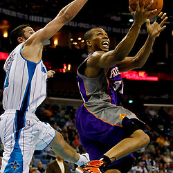 February 2, 2012; New Orleans, LA, USA; Phoenix Suns point guard Sebastian Telfair (31) shoots over New Orleans Hornets point guard Greivis Vasquez (21) during the second half of a game at the New Orleans Arena. The Suns defeated the Hornets 120-103.  Mandatory Credit: Derick E. Hingle-US PRESSWIRE