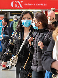 © Licensed to London News Pictures. 03/03/2020. London, UK. Commuters head to work wearing a masks at Victoria Stn in Westminster as Boris Johnson announces his battle plan in Downing Street for combating the coronavirus crisis. Photo credit: Alex Lentati/LNP