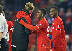 LIVERPOOL, ENGLAND - Wednesday, January 20, 2016: Liverpool's manager Jürgen Klopp hugs goalscorer Sheyi Ojo after the 3-0 victory over Exeter City during the FA Cup 3rd Round Replay match at Anfield. (Pic by David Rawcliffe/Propaganda)