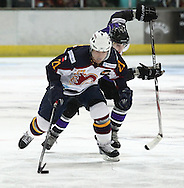 16 Jan 2010: Guildford, England. Milos Melicherik (21) of Guildford Flames attacks with the puck during the game between Guildford Flames and Manchester Phoenix at Guildford (photo by Andrew Tobin/Slik Images)