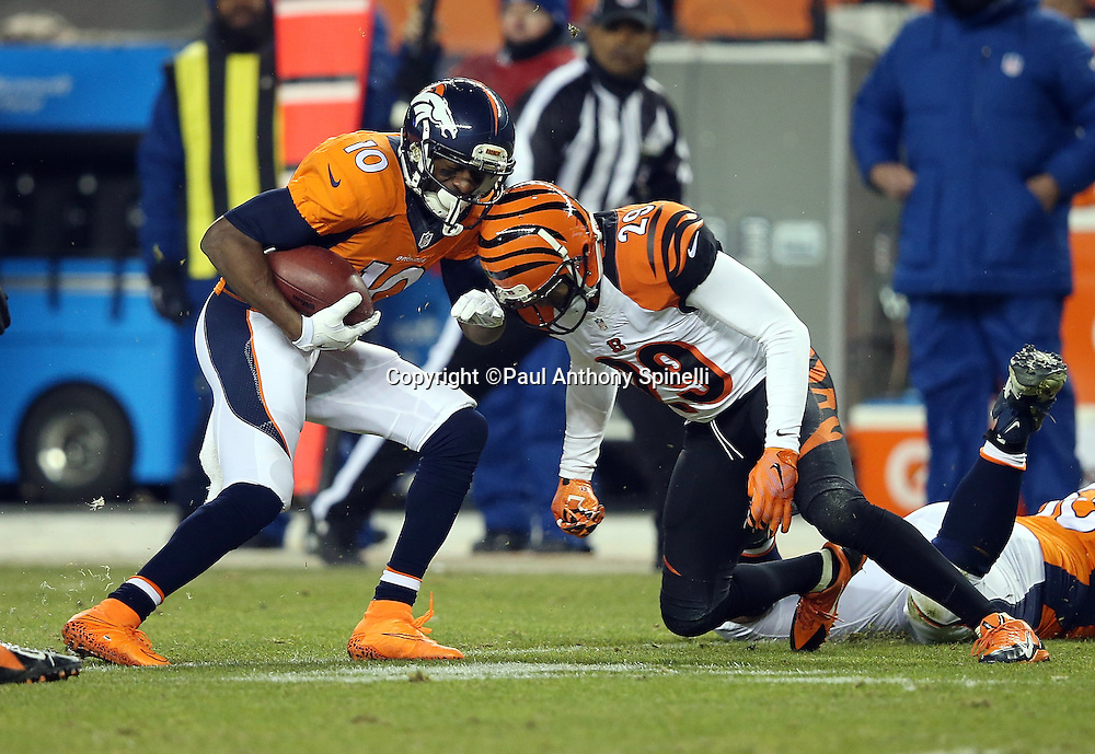 Denver Broncos wide receiver Emmanuel Sanders (10) gets hit hard by Cincinnati Bengals strong safety Leon Hall (29) as he catches a third quarter pass for a gain of 8 yards during the 2015 NFL week 16 regular season football game against the Cincinnati Bengals on Monday, Dec. 28, 2015 in Denver. The Broncos won the game in overtime 20-17. (©Paul Anthony Spinelli)