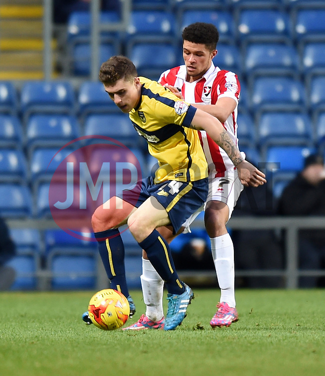 Cheltenham Town's Kane Ferdinand keeps up the pressure on Oxford United's Josh Ruffels - Photo mandatory by-line: Paul Knight/JMP - Mobile: 07966 386802 - 03/01/2015 - SPORT - Football - Oxford - Kassam Stadium - Oxford United v Cheltenham Town - Sky Bet League Two