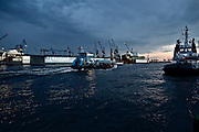 Hamburg | 30 Apr 2015<br /> <br /> A ferryboat is cruising on the river Elbe in front of dock 10 of Blohm &amp; Voss shipyard in the evening close to Landungsbruecken.<br /> <br /> &copy;peter-juelich.com<br /> <br /> [No Model Release | No Property Release]