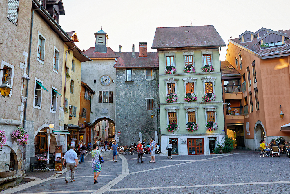 View of Neo-Classic buildings, and a cobblestone walkway heading into the Old Town Annecy market, Old Town Annecy, France.