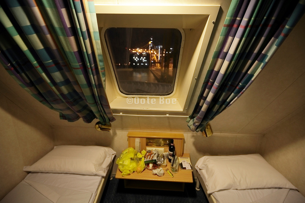 passenger cabin while in harbor with view on a large container ship