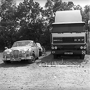 1960's Daimler car next to a DAF truck,at Glastonbury, 1989.