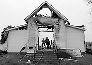 A burned out entry is all that remains of the Hawcreek Missionary Baptist Church north of Hope IN. Tuesday after an early morning fire destroyed the historic structure. Officials ruled the fire as arson.