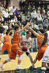 01 March 2014:  Dylan Overstreet works against Tyler Peter to get off a shot from the paint during an NCAA mens division 3 CCIW  Championship basketball game between the Wheaton Thunder and the Illinois Wesleyan Titans in Shirk Center, Bloomington IL