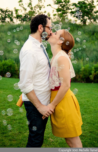 Bubbles at a fun engagement session in New York City.  Image by New York Wedding Photographer Michelle Turner.