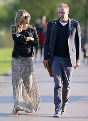 Pregnant model Abbey Clancy wearing a black cardigan, black top, pattern maxi skirt a pair of flip flops enjoying the sunshine at a park in north London, UK. 14/04/2015<br /> BYLINE MUST READ : JAMESY/GOTCHA IMAGES<br /> <br /> Copyright by © Gotcha Images Ltd. All rights reserved.<br /> Usage of this image is conditional upon the acceptance <br /> of Gotcha Images Ltd, terms and conditions available at<br /> www.gotchaimages.com