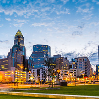 Panorama photo of Charlotte skyline and Romare Bearden Park at dusk. Charlotte, North Carolina is a major city in the Eastern United States of America. Panoramic photo ratio is 1:3.