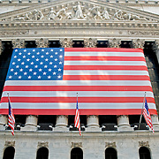 New York Stock Exchange with large American flag