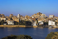 River Nile and colonial mansions in foreground Gezira island Cairo. Egypt