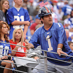 Fans take in first half NFL football action between the New York Giants and Tennessee Titans at New Meadowlands Stadium in East Rutherford, New Jersey. The game is tied at half time.