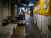 23 FEBRUARY 2018 - BANGKOK, THAILAND: An aisle in Pratunam Market with shuttered shops. Pratunam Market was one of the largest clothing markets in Bangkok. New airconditioned markets, like Platinum and Palladium malls opened nearby, siphoning away customers. Now there are only a handful of merchants left in the market and Bangkok city officials have plans to shut the market and redevelop the land.      PHOTO BY JACK KURTZ