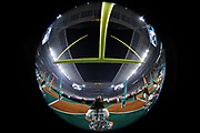 A Miami Dolphins cheerleader stands under the goal post as the American flag is draped over the field during the singing of the National Anthem in this wide angle general view photograph taken with a fisheye lens before the Miami Dolphins 2017 NFL week 14 regular season football game against the New England Patriots, Monday, Dec. 11, 2017 in Miami Gardens, Fla. The Dolphins won the game 27-20. (©Paul Anthony Spinelli)