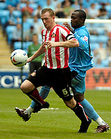 Photo: Ed Godden.<br /> Coventry City v Sunderland. Coca Cola Championship. 06/08/2006. Steven Caldwell (L) is tackled by Coventry's Stern John.