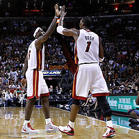 19 March 2011: Miami Heat small forward LeBron James (6) celebrates with Miami Heat power forward Chris Bosh (1) during the Miami Heat 103-98 victory over the Denver Nuggets at the AmericanAirlines Arena, Miami, Florida, USA.