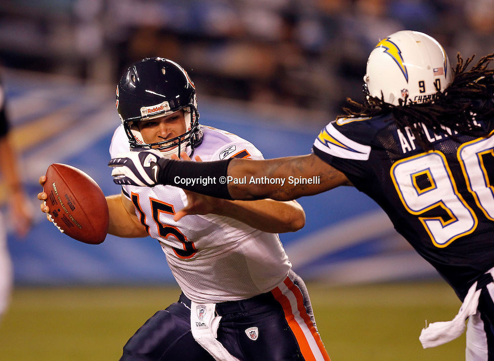 Chicago Bears rookie quarterback Dan LeFevour (15) tries to elude a sack by San Diego Chargers linebacker Antwan Applewhite (90) during a NFL week 1 preseason football game against the San Diego Chargers, Saturday, August 14, 2010 in San Diego, California. The Chargers won the game 25-10. (©Paul Anthony Spinelli)
