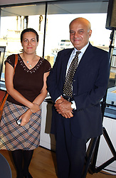 Heart surgeon PROF.SIR MAGDI YACOUB and his daughter MISS LISA YACOUB at a party to celebrate the UK launch of Diana:The Portrait, the authorised book about the late Princess Of Wales's life and work, held at the National Portrait Gallery, London on 1st September 2004.  The book was commissioned by The Diana, Princess of Wales Memorial Fund and writen by Ros Coward.