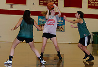 Becca Howe looks for a pass during Monday night's scrimmage with Newfound at Laconia High School.  (Karen Bobotas/for the Laconia Daily Sun)