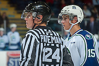 KELOWNA, CANADA - OCTOBER 7:  Glenn Gawdin #15 of Swift Current Broncos stands on the ice alongside Ward Pateman, linesman on October 7, 2014 at Prospera Place in Kelowna, British Columbia, Canada.  (Photo by Marissa Baecker/Getty Images)  *** Local Caption *** Ward Pateman; Glenn Gawdin;