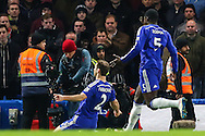 Branislav Ivanovic of Chelsea (left) celebrates scoring the opening goal against Liverpool during the Capital One Cup Semi Final 2nd Leg match between Chelsea and Liverpool at Stamford Bridge, London, England on 27 January 2015. Photo by David Horn.