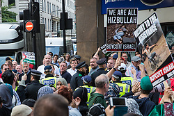 London, UK. 10th June, 2018. Members of a far-right group taunt hundreds of people taking part in the pro-Palestinian Al Quds Day march through central London organised by the Islamic Human Rights Commission. An international event, it began in Iran in 1979. Quds is the Arabic name for Jerusalem.