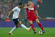 (R) Poland's Mariusz Lewandowski fights for the ball with (L) England's Andros Townsend during the 2014 World Cup Qualifying Group H football match between England and Poland at Wembley Stadium in London on October 15, 2013.<br /> <br /> Great Britain, London, October 15, 2013<br /> <br /> Picture also available in RAW (NEF) or TIFF format on special request.<br /> <br /> For editorial use only. Any commercial or promotional use requires permission.<br /> <br /> Mandatory credit:<br /> Photo by &copy; Adam Nurkiewicz / Mediasport