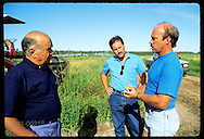 Erico Ribeiro, world's largest rice grower, talks w/ Monsanto rep and agronomist on farm; RS. Brazil
