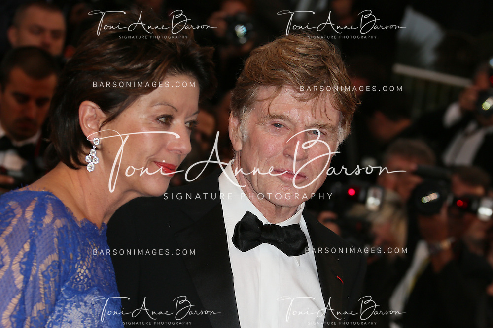 CANNES, FRANCE - MAY 22:  Sibylle Szaggars and Robert Redford attend the Premiere of 'All Is Lost' during The 66th Annual Cannes Film Festival at the Palais des Festivals on May 22, 2013 in Cannes, France.  (Photo by Tony Barson/FilmMagic)