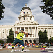 The 2014 USA Track and Field  Championships in Sacramento: Reese Hoffa throws the shotput in front of the California State Capitol Building on his way to a third place finish in the men's finals.