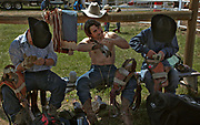 Cowboys prepare for the bareback bronco riding during the 94th Annual Falkland Stampede in Falkland, BC (2012)