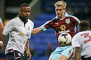 Ben Mee (Burnley) tries to get to the ball ahead of Liam Trotter (Bolton Wanderers) during the Pre-Season Friendly match between Bolton Wanderers and Burnley at the Macron Stadium, Bolton, England on 26 July 2016. Photo by Mark P Doherty.