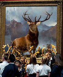 pupils from St Ninians primary school - all wearing antlers to mark the occasion - hear about the  launch the nationwide tour of the famous 'Monarch of the Glen' painting by Sir Edwin Landseer.<br /> <br /> &copy; Dave Johnston/ EEm