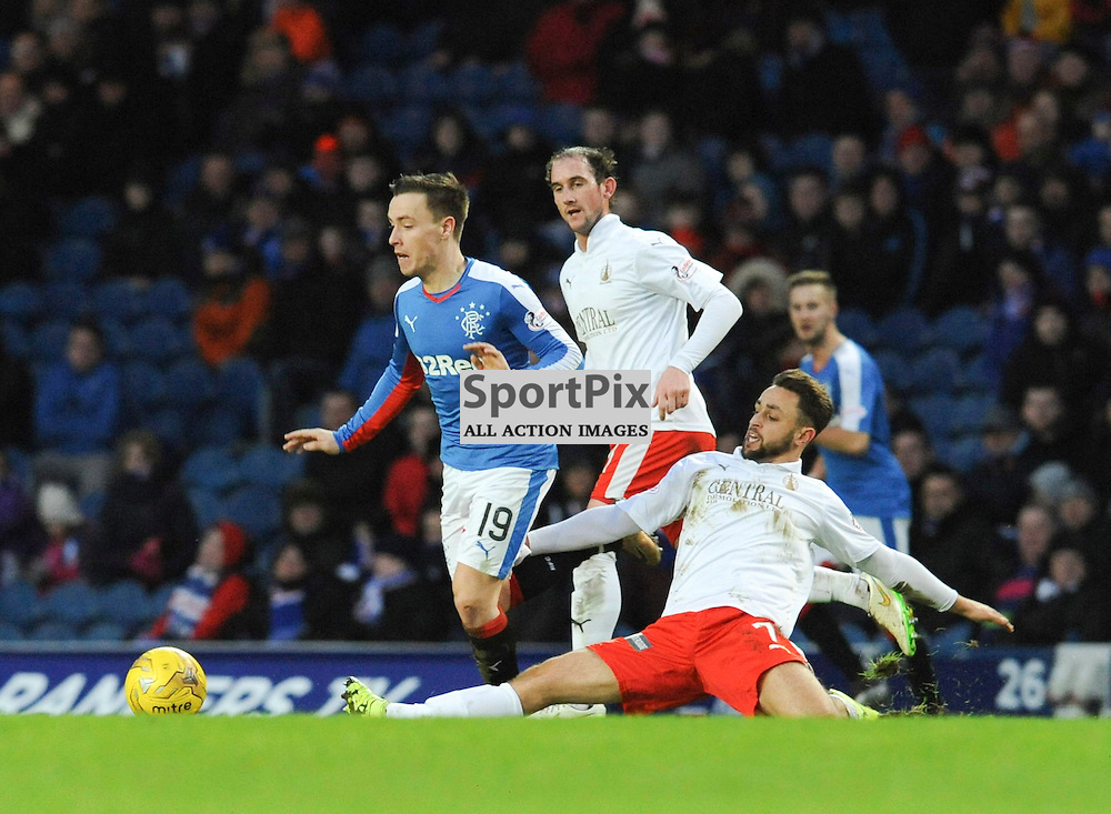 Tom Taiwo slides in to tackle Barrie McKay during the Ladbrokes Championship match between Rangers v Falkirk, Ibrox Stadium, Saturday 30 January 2016 (c) Angie Isac | SportPix.org.uk