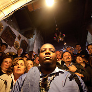P. Michael Williams descends into the the crypt at the Church of the Nativity in Bethlehem in the West Bank.  Hundreds of Christians make the journey daily into the Grotto of the Nativity where a silver star marks the spot where Mary is believed to have given birth to Jesus of Nazareth.    [WILLIE J. ALLEN JR.]