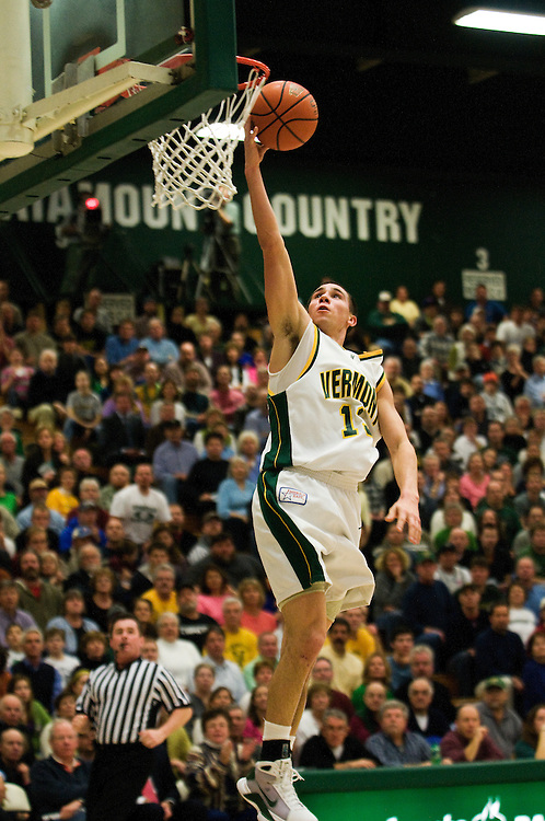 11 February 2009: Catamount senior guard Mike Trimboli #13 leaps for the lay up during the Vermont Catamounts 75-47 win over the Boston Terriers at Patrick Gym in Burlington, Vermont.